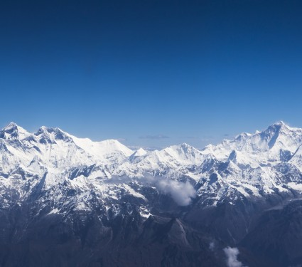 Aerial view of 3 giants of the earth, Everest, Makalu and Lothse . High mountain and high altitude.